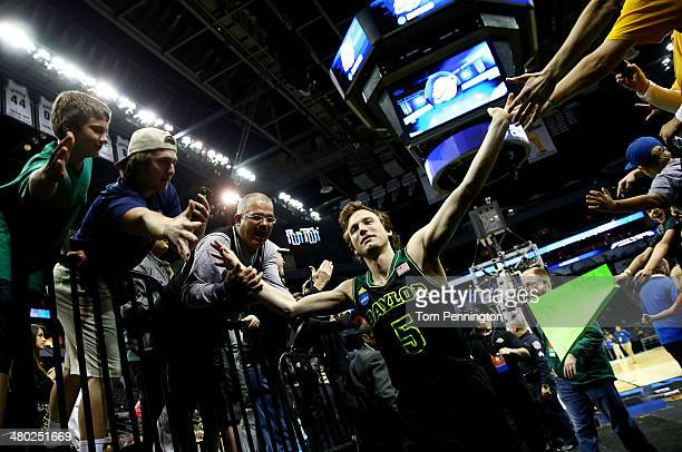Brady Heslip of the Baylor Bears celebrates with fans after defeating the Creighton Bluejays 8555 in the third round of the 2014 NCAA Men's...