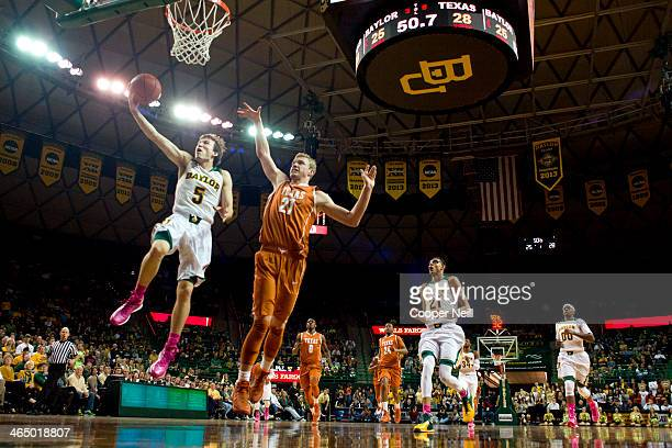 Brady Heslip of the Baylor Bears drives to the basket against the Texas Longhorns on January 25 2014 at the Ferrell Center in Waco Texas