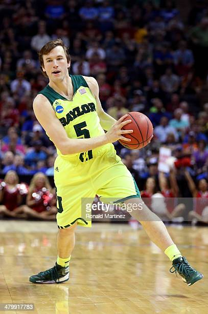 Brady Heslip of the Baylor Bears handles the ball against Nebraska Cornhuskers in the second half during the second round of the 2014 NCAA Men's...