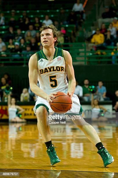 Brady Heslip of the Baylor Bears pulls up for a threepointer against the West Virginia Mountaineers on January 28 2014 at the Ferrell Center in Waco...