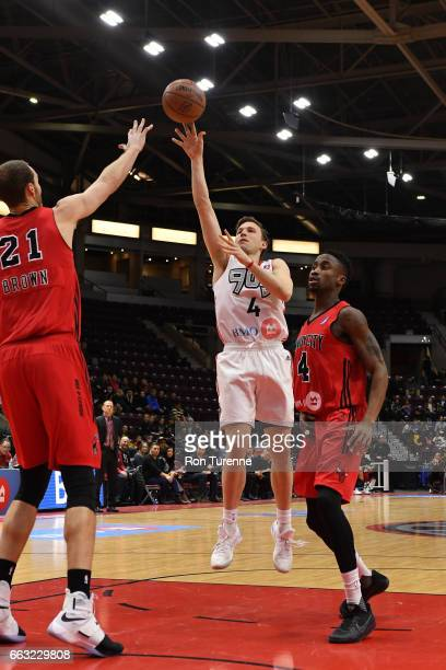 Brady Heslip of the Raptors 905 drives to the basket and shoots the ball against the Windy City Bulls on March 30 2017 in Mississauga Ontario Canada...
