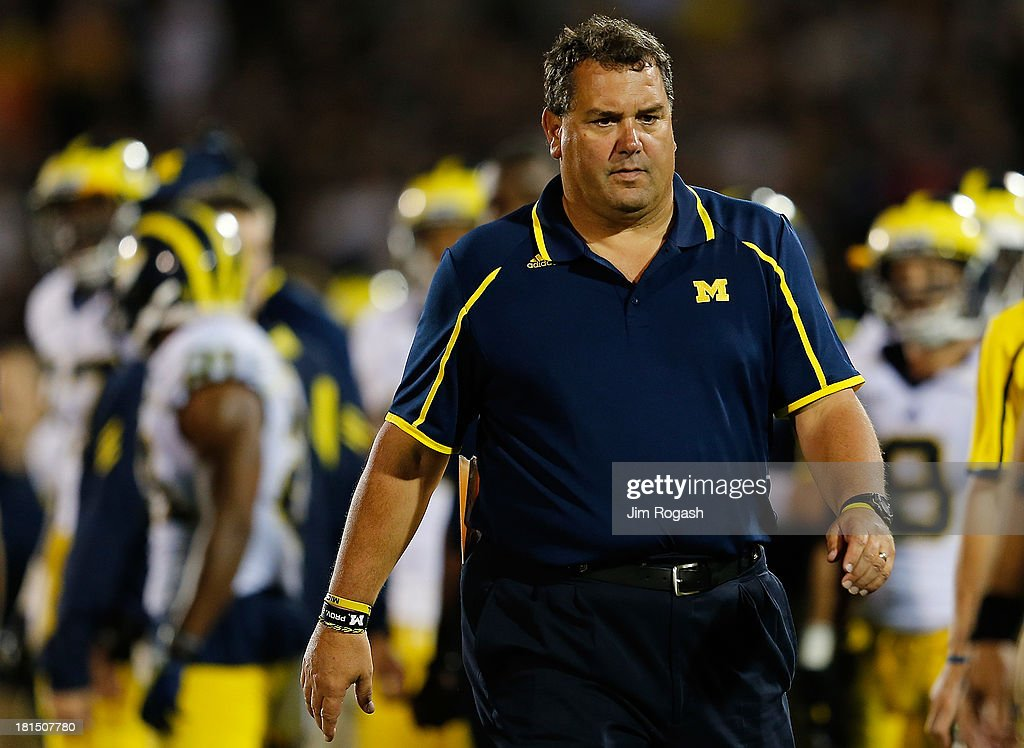 Brady Hoke, coach of the Michigan Wolverines walks the sideline in the second half against the Connecticut Huskies at Rentschler Field on September 21, 2013 in East Hartford, Connecticut.