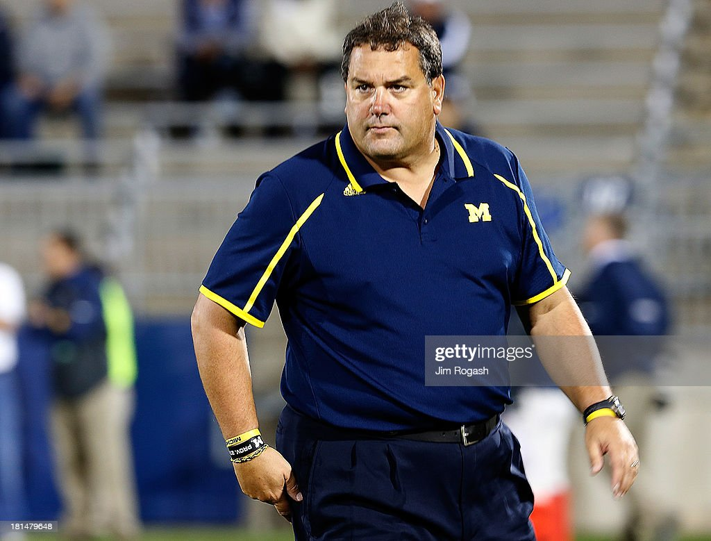 Brady Hoke, coach of the Michigan Wolverines watches the pre-game action before a game with the Connecticut Huskies at Rentschler Field on September 21, 2013 in East Hartford, Connecticut.