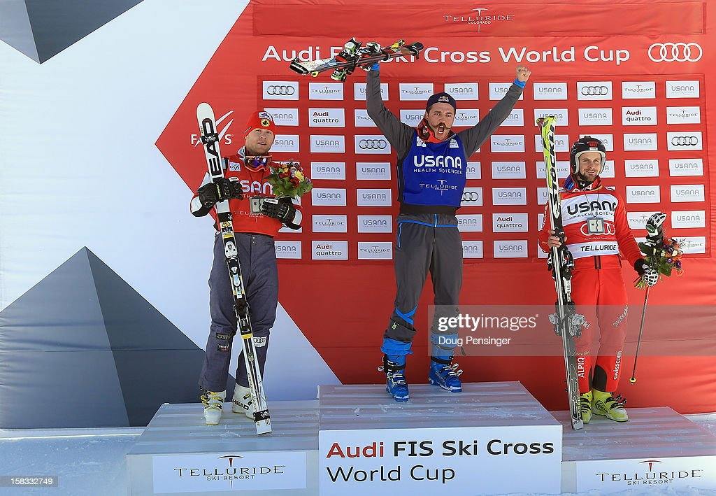 Brady Leman of Canada in second place, Filip Flisar of Slovenia in first place and Armin Niederer of Switzerland in third place take the podium for the men's Audi FIS Ski Cross World Cup on December 12, 2012 in Telluride, Colorado.