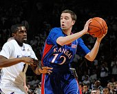 Brady Morningstar of the Kansas Jayhawks looks to make a pass against pressure from Fred Brown of the Kansas State Wildcats on February 14 2009 at...