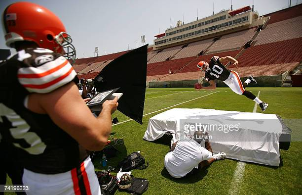 Brady Quinn of the Cleveland Browns performs a diving pass for a photographer as new team mate Joe Thomas watches on at the 2007 NFL Players Rookie...
