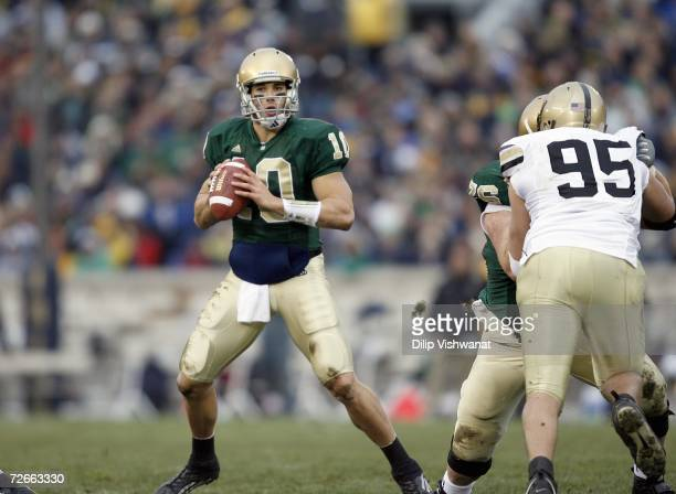 Brady Quinn of the Notre Dame Fighting Irish looks to pass against the Army Black Knights at Notre Dame Stadium November 18 2006 in South Bend...