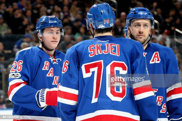 Brady Skjei Jimmy Vesey and Derek Stepan of the New York Rangers talk during a break in the action against the Anaheim Ducks at Madison Square Garden...