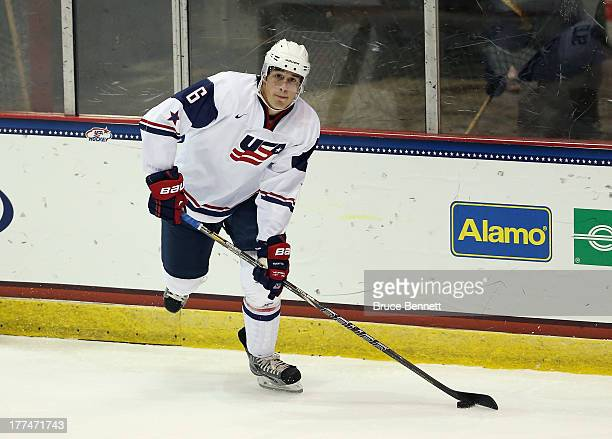 Brady Skjei of Team USA skates against Team Sweden during the 2013 USA Hockey Junior Evaluation Camp at the Lake Placid Olympic Center on August 7...