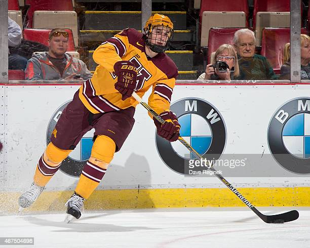 Brady Skjei of the Minnesota Golden Gophers passes the puck against the Michigan Wolverines during the finals of Big Ten Mens Ice Hockey Championship...