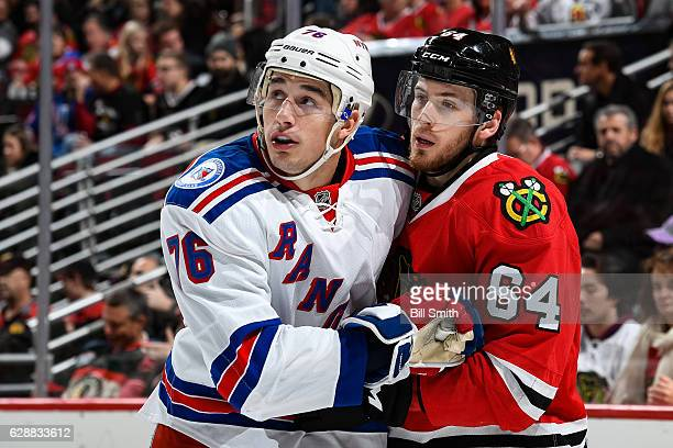 Brady Skjei of the New York Rangers and Tyler Motte of the Chicago Blackhawks look down the ice in the first period at the United Center on December...