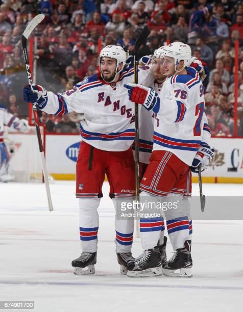 Brady Skjei of the New York Rangers celebrates his second period goal against the Ottawa Senators with teammates Mika Zibanejad and Ryan McDonagh in...