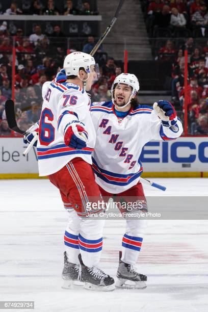 Brady Skjei of the New York Rangers celebrates his third period goal against the Ottawa Senators with teammate Mats Zuccarello in Game Two of the...