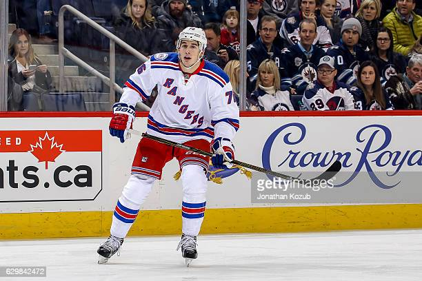 Brady Skjei of the New York Rangers keeps an eye on the play during first period action against the Winnipeg Jets at the MTS Centre on December 8...