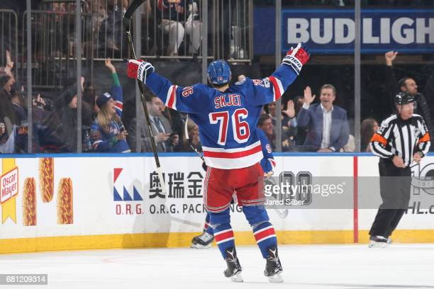Brady Skjei of the New York Rangers reacts after a goal by Mika Zibanejad in the second period against the Ottawa Senators in Game Six of the Eastern...