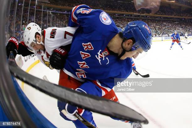Brady Skjei of the New York Rangers skates against Kyle Turris of the Ottawa Senators in Game Three of the Eastern Conference Second Round during the...