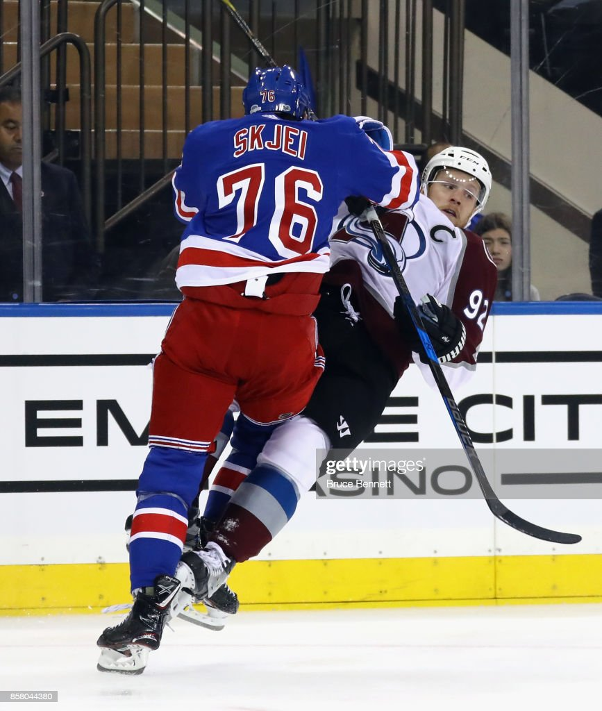 Brady Skjei #76 of the New York Rangers steps into Gabriel Landeskog #92 of the Colorado Avalanche during the first period at Madison Square Garden on October 5, 2017 in New York City.