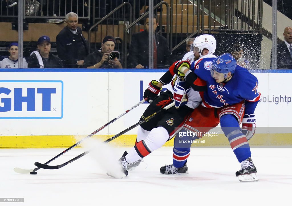 Brady Skjei #76 of the New York Rangers takes a penalty for holding Viktor Stalberg #24 of the Ottawa Senators in Game Three of the Eastern Conference Second Round during the 2017 NHL Stanley Cup Playoffs at Madison Square Garden on May 2, 2017 in New York City. The Rangers defeated the Senators 4-1.