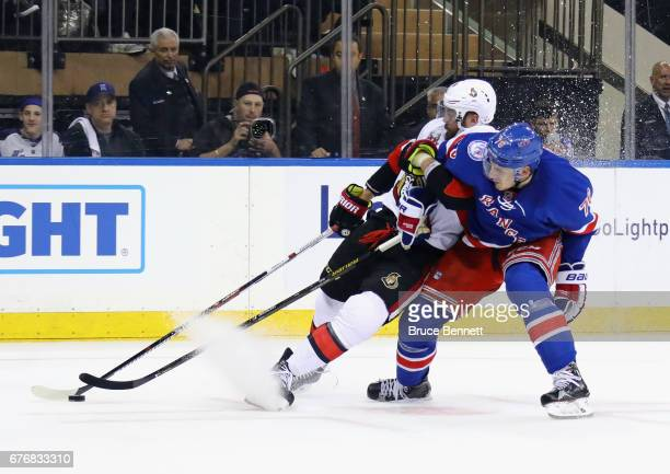 Brady Skjei of the New York Rangers takes a penalty for holding Viktor Stalberg of the Ottawa Senators in Game Three of the Eastern Conference Second...