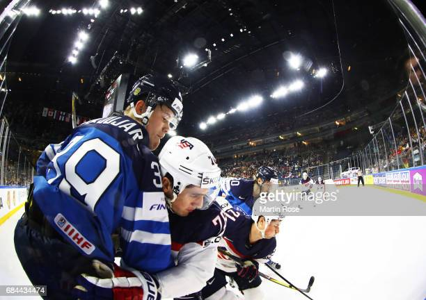 Brady Skjei of the USA is challenged by Jesse Puljujarvi of Finland during the 2017 IIHF Ice Hockey World Championship Quarter Final game between USA...