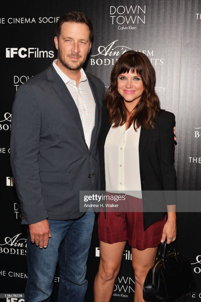 Brady Smith and Actress Tiffani Thiesse attend the Downtown Calvin Klein with The Cinema Society screening of IFC Films' 'Ain't Them Bodies Saints'...