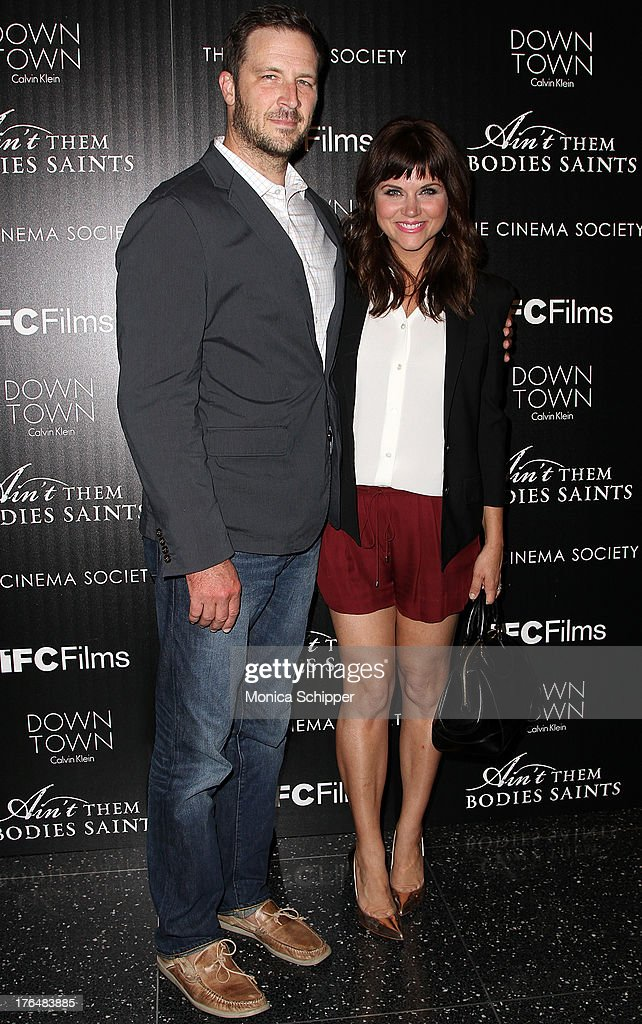 <a gi-track='captionPersonalityLinkClicked' href=/galleries/search?phrase=Brady+Smith&family=editorial&specificpeople=223901 ng-click='$event.stopPropagation()'>Brady Smith</a> and actress <a gi-track='captionPersonalityLinkClicked' href=/galleries/search?phrase=Tiffani+Thiessen&family=editorial&specificpeople=221649 ng-click='$event.stopPropagation()'>Tiffani Thiessen</a> attends the Downtown Calvin Klein with The Cinema Society screening of IFC Films' 'Ain't Them Bodies Saints' at The Museum of Modern Art on August 13, 2013 in New York City.