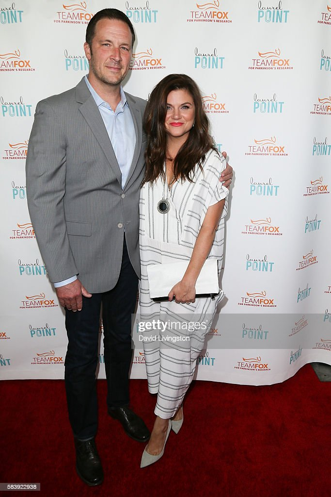 Brady Smith and Tiffani Thiessen arrive at Raising The Bar To End Parkinson's at Laurel Point on July 27, 2016 in Studio City, California.