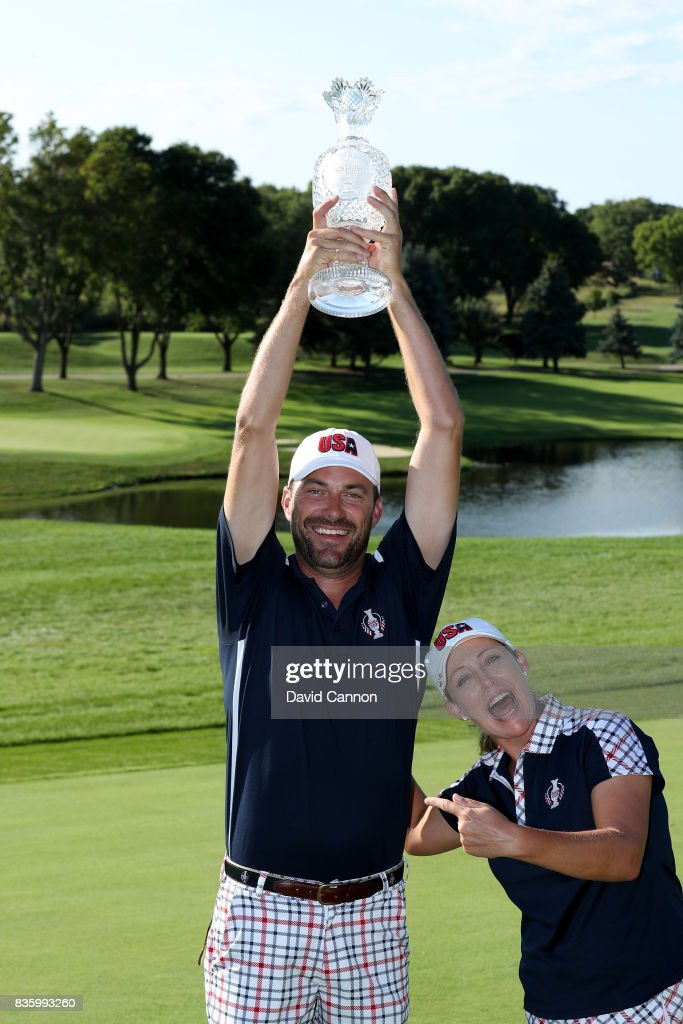 Brady Stockton the caddie of Cristie Kerr of the United States Team holds the Solheim Cup high above her after the closing ceremony during the final day singles matches in the 2017 Solheim Cup at the Des Moines Golf Country Club on August 20, 2017 in West Des Moines, Iowa.