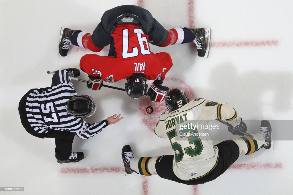 Brady Vail #97 of the Windsor Spitfires takes a faceoff against Bo Horvat #53 of the London Knights in an OHL game on December 27, 2012 at the Budweiser Gardens in London, Canada. The Knights defeated the Spitfires 9-4 to extend their winning streak to 22 games.