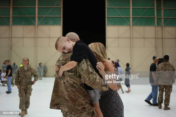 Bradyn Vest embraces his father Sgt 1st Class Kevin Vest of the US Army's 159th Combat Aviation Brigade 101st Airborne Division following a...