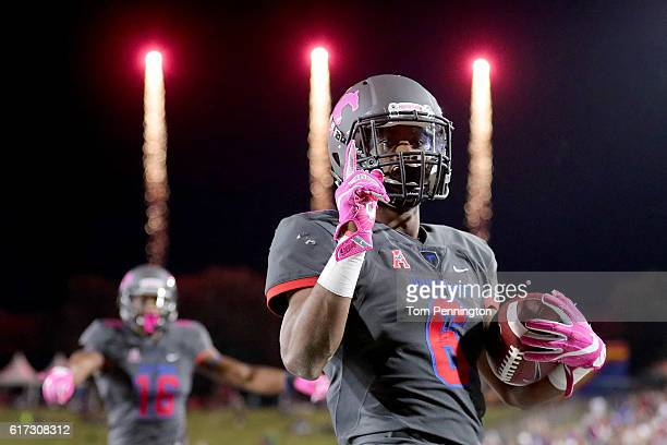 Braeden West of the Southern Methodist Mustangs celebrates after scoring a touchdown against Terrell Williams of the Houston Cougars in the fourth...