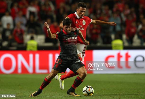 Braga forward Joao Carlos Teixeira from Portugal with SL Benfica midfielder Andreas Samaris from Greece in action during the Portuguese League Cup...