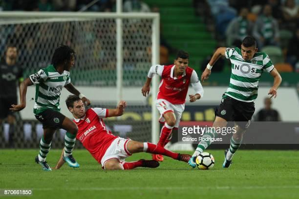 Braga midfielder Nikola Vukcevic from Montenegro tries to stop Sporting CP midfielder Rodrigo Battaglia from Argentina during the Portuguese Primeira...