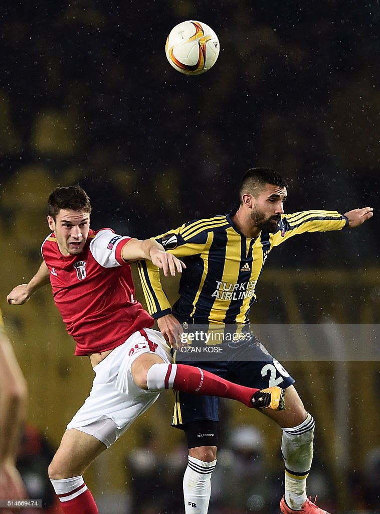 Braga's Baiano vies for the ball with Fenerbahce's Alper Potuk during the UEFA Europa League round of 16 football match between Fenerbahce and Braga...