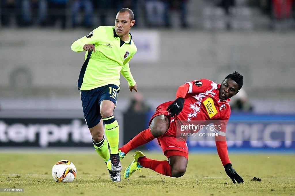 Braga's Brazilian defender Baiano vies with Sion's Ghanaian forward Ebenezer Assifuah during the UEFA Europa League round of 32 first leg football...