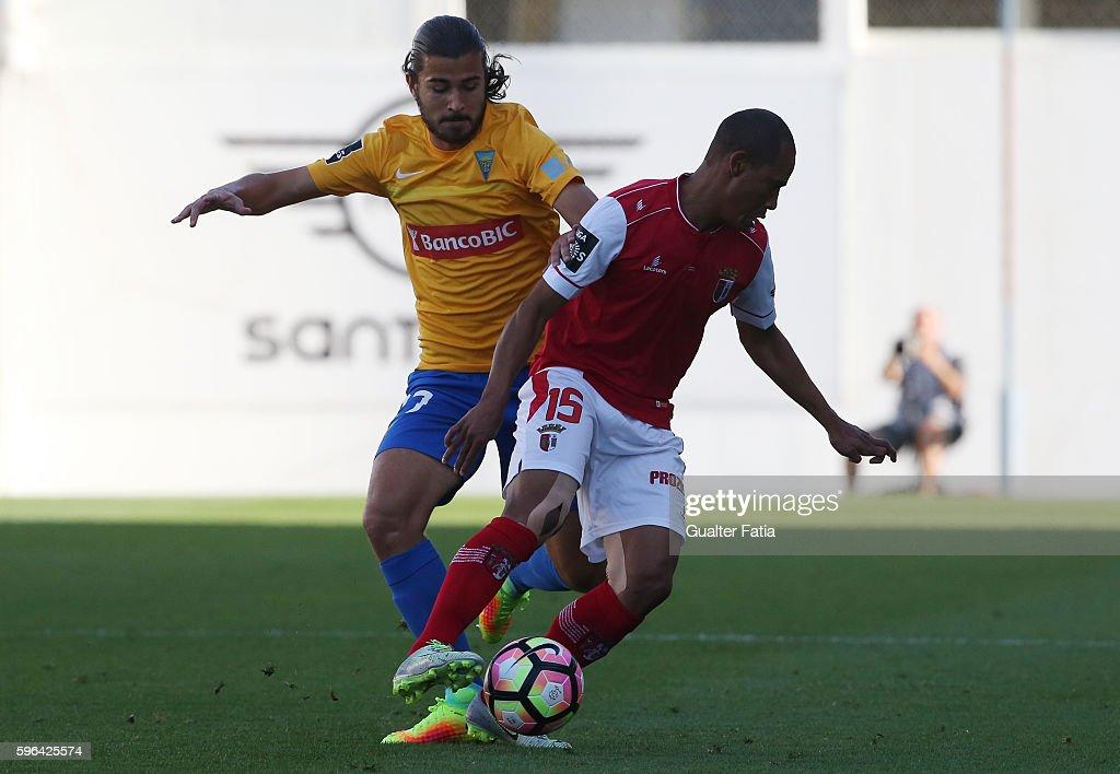 Braga's Brazilian defender Baiano with Estoril's midfielder Mattheus Bebeto from Brazil in action during the Primeira Liga match between GD Estoril...