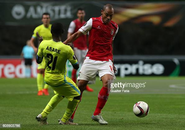 Braga's Brazilian defender Baiano with Gent's defender Nana Asare from Ghana in action during the UEFA Europa League match between SC Braga and KAA...