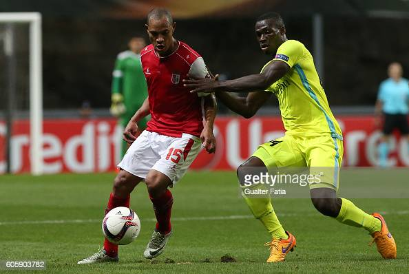 Braga's Brazilian defender Baiano with Gent's midfielder Anderson Esiti from Nigeria in action during the UEFA Europa League match between SC Braga...