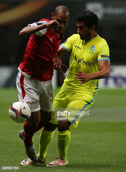 Braga's Brazilian defender Baiano with Gent's midfielder Kenneth Saief from Israel in action during the UEFA Europa League match between SC Braga and...