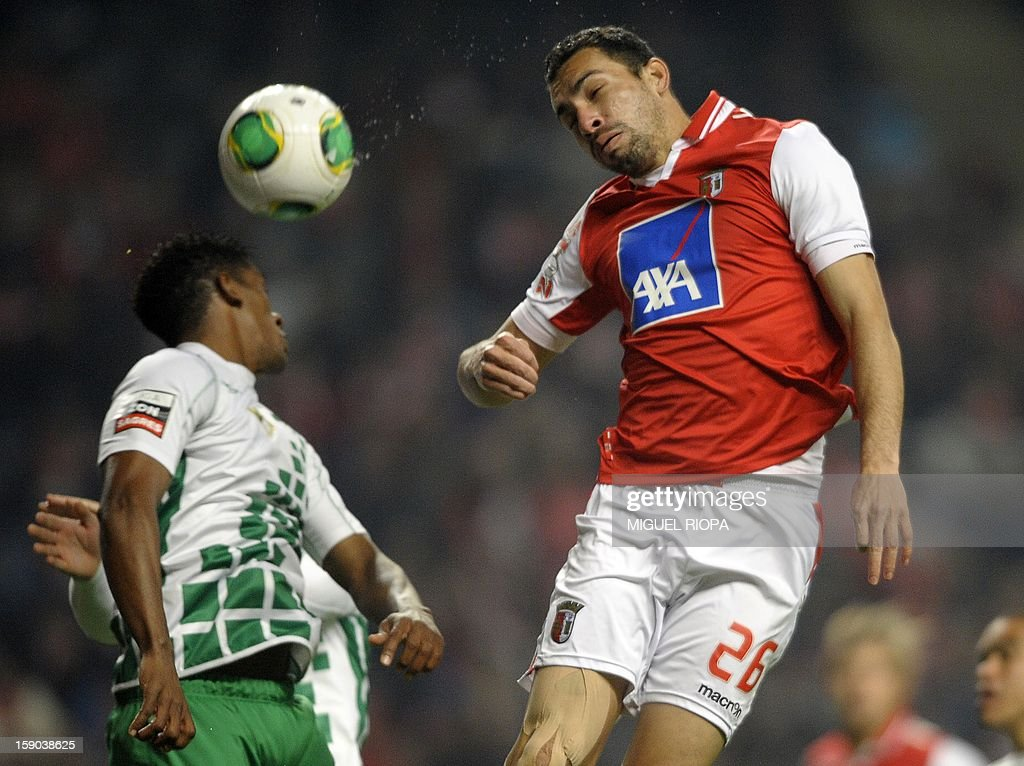 SC Braga's Brazilian defender Paulo Vinicius (R) heads the ball with Moreirense's Brazilian midfielder Julio Cesar during the Spanish league football match FC Barcelona vs RCD Espanyol at the Camp Nou stadium in Barcelona on January 6, 2013. AFP PHOTO/ MIGUEL RIOPA