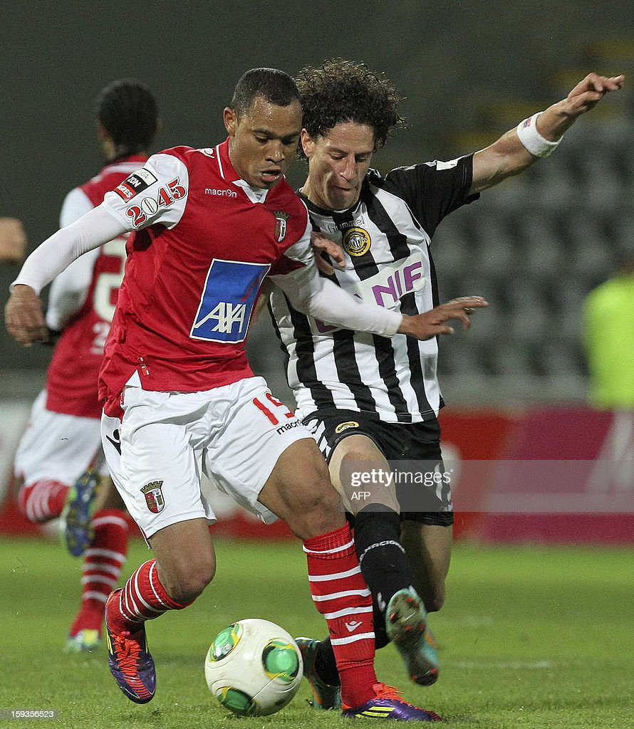 Braga's Brazilian defender Wanderson Baiano (L) vies with Nacional's Brazilian forward Mario Rondon during the Portuguese Liga football match CD Nacional vs SC Braga at Madeira Stadium in Funchal on January 12, 2013.
