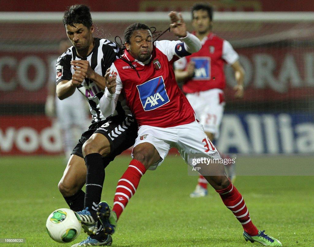 Braga's Brazilian midfielder Alan (R) vies with Nacional's Brazilian defender Moreno (L) during the Portuguese Liaga football match CD Nacional vs SC Braga at Madeira Stadium in Funchal on January 12, 2013.