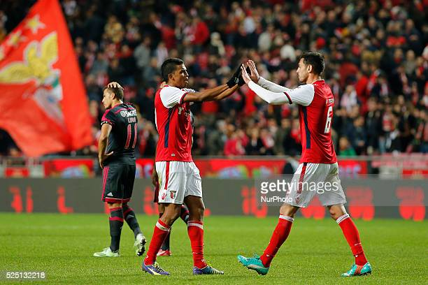 Braga's defender Aderlan Santos celebrates his side's win with Braga's defender Andre Pinto at the end of the Portuguese Cup football match between...