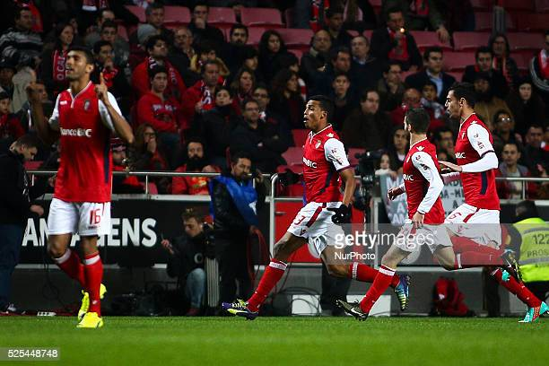 Braga's defender Aderlan Santos celebrates with team mates after scoring during the Portuguese Cup football match between SL Benfica and SC Braga at...