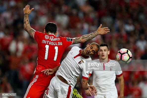 Braga's defender Baiano heads for the ball with Benfica's forward Kostas Mitroglou during Premier League 2016/17 match between SL Benfica v SC Braga...