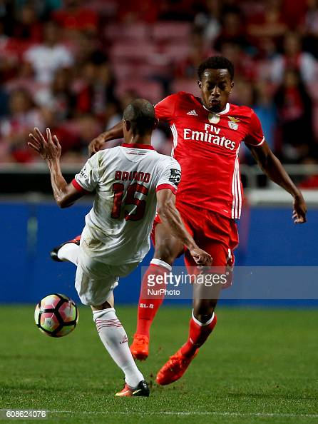 Braga's defender Baiano vies for the ball with Benfica's forward Andre Carrillo during Premier League 2016/17 match between SL Benfica v SC Braga in...