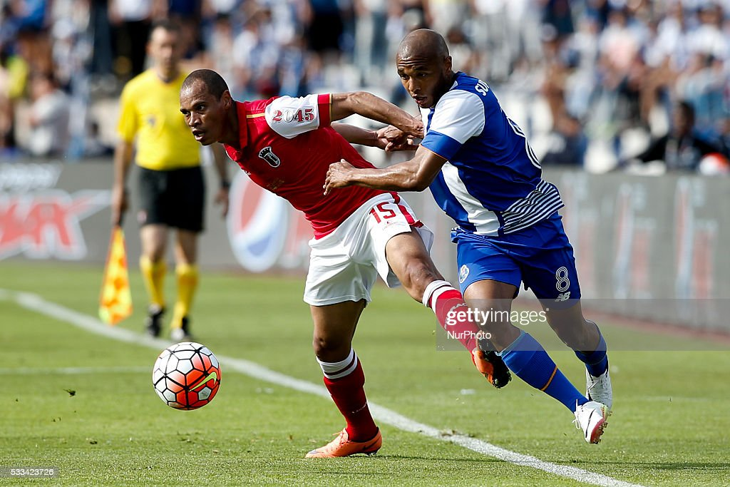 Braga's defender Baiano vies for the ball with Porto's midfielder Yacine Brahimi during the Portuguese Cup football match between FC Porto and SC...