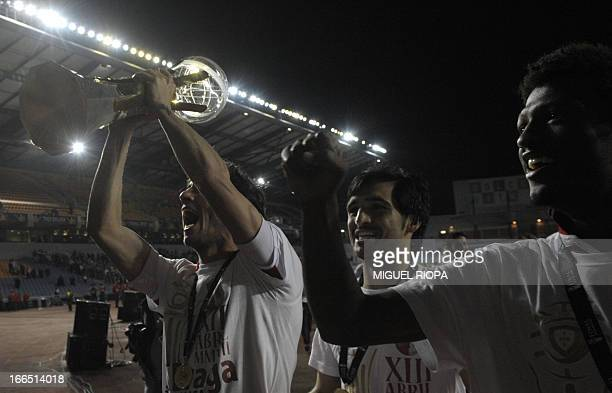 SC Braga's defender Nuno Coelho midfielder Custodio Castro and Cape Verdean forward Ze Luis celebrate their victory with supporters at the end of the...