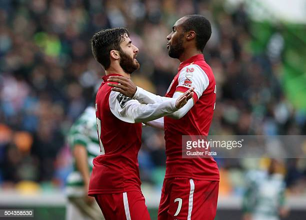 Braga's forward Rafa Silva celebrates with teammate Wilson Eduardo after scoring a goal during the Primeira Liga match between Sporting CP and SC...