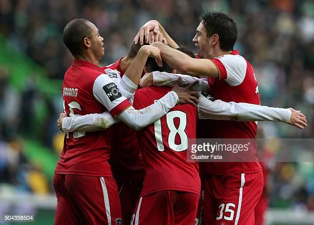 Braga's forward Rafa Silva celebrates with teammates after scoring a goal during the Primeira Liga match between Sporting CP and SC Braga at Estadio...